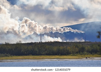 The smoke of the Norilsk combine. The sky in the smoke from the chimneys of Norilsk Nickel plant.