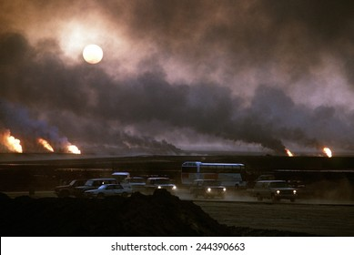 The smoke from oil well fires forces Kuwait drivers to use their headlights during daylight. Retreating Iraqi troops set fire to Kuwait's oil fields. April 22 1991.