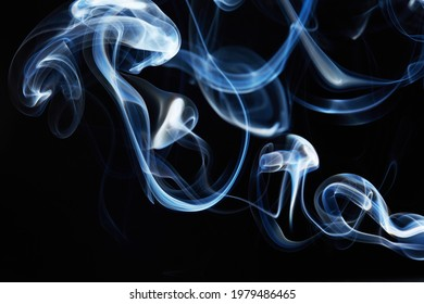 smoke on black background with abstract blur motion wave swirl . Wisp of Smoke. Cigarette smoke waves and clouds  texture