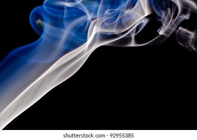 Smoke on a black background. Isolated on black.