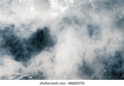 smoke on dark background.