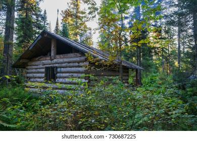 Smoke over hunter hut. Eastern Sayan range, Krasnoyarsk region, Siberia, Russia.