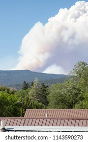 Smoke over rooftops from the 416 forest fire in Durango, Colorado