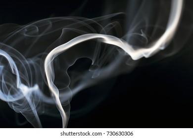 Smoke pattern over a black background