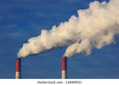 Smoke from a pipe on a background of blue sky