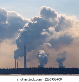 Smoke from pipes in a factory pollutes nature .