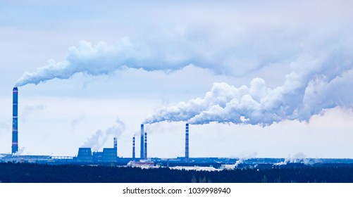 Smoke from the pipes of an industrial plant in the morning