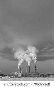 Smoke of pipes in winter Yakutsk city
