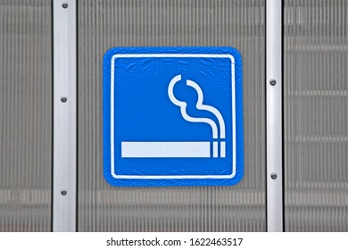 smoke place as blue sign on plastic wall, healthcare environment diversity