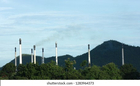Smoke Pollution from  smokestack of factory in volley of forest , bad environment from factory