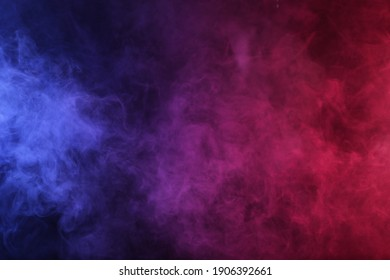 Smoke in red-blue light on black background