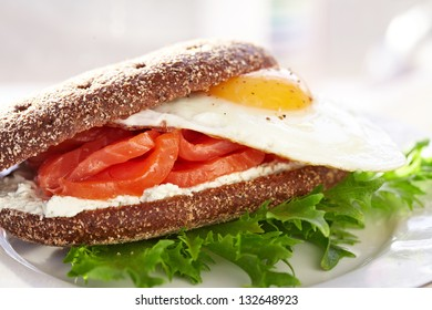 Smoke salmon, cream cheese and egg sandwich