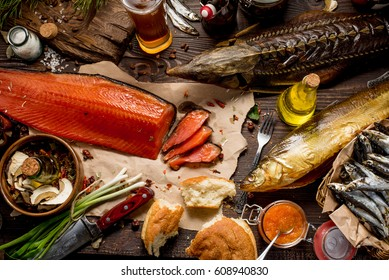 Smoke salmon on craft paper at wooden table. Tenderloin fish still life. Country meal.