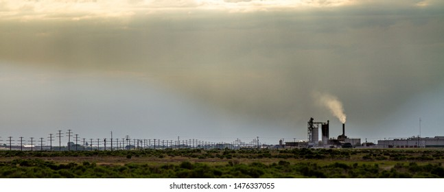 Smoke stack emitting pollution up into the environment
