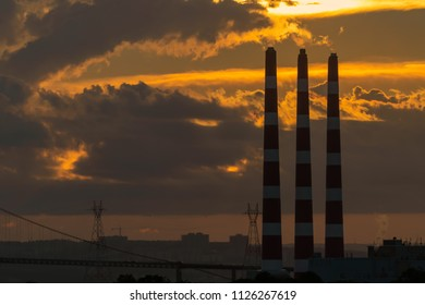 Smoke stacks from a coal fired power plant at dusk.