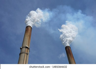 Smoke stacks from a coal-burning power plant