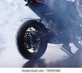 Smoke from the starting motobike close up