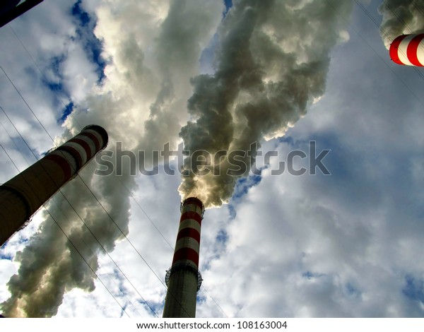 smoke and steam from the high chimney power plant