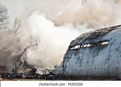 Smoke and steam rising from remains of a large aircraft after crashing