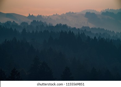 Smoke from the summer 2018 California wildfires glows under the setting sun