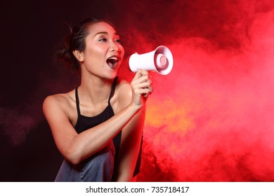 Smoke Tan Skin Asian Woman black hair dark lip with megaphone shout White Smoke and Fog on red dark Background, Abstract Smoke Clouds, and high low exposure contrast, copy space for text logo