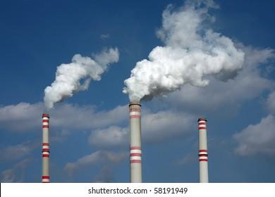 smoke from three coal power plant chimney