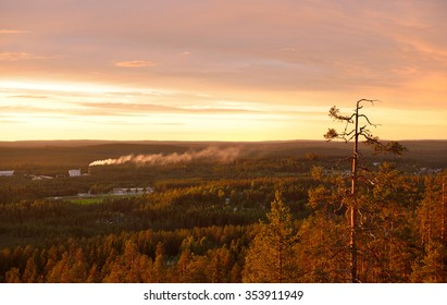 Smoke in valley at sunset. Finnish Lapland
