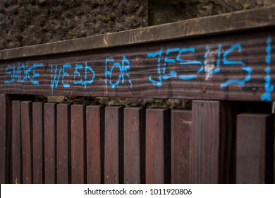"""""""Smoke weed for Jesus"""" text sign, hand-painted on a street in the German city of Nürnberg."""