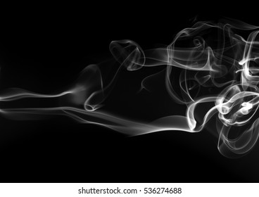 Smoke the white incense on a black background for design. darkness concept