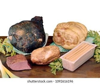 smoked and baked ham, smoked meat and smoked turkey, würstel, on wooden table