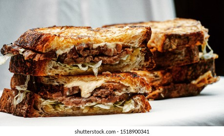 Smoked beef brisket with cheese sandwich.