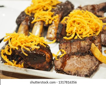 Smoked beef meat (daging sapi asap) food with fried onion served on a white plate isolated. Top view close up details.