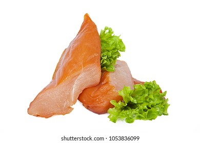 Smoked chicken breast with lettuce leaves. Tender and fresh meat. Isolated on white background