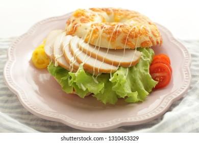 Smoked chicken and mayonnaise bagel sandwich