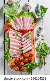 Smoked cold meats with pepper and herbs