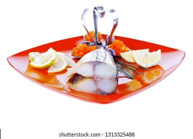 smoked fish with lemon and caviar on red