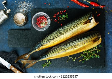 smoked fish, fish with red pepper, fish on the board