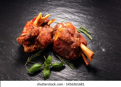 Smoked ham hock with herbs and spices. Roasted pork knuckle. Ham and bacon are popular foods in the west. German Schweinshaxe or Haxe