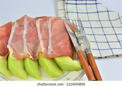 Smoked ham on melons