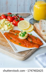 Smoked kipper brunch with scrambled egg and tomatoes