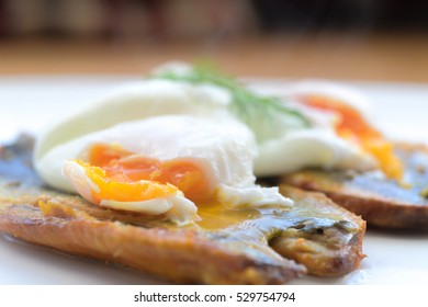 Smoked kipper and poached eggs