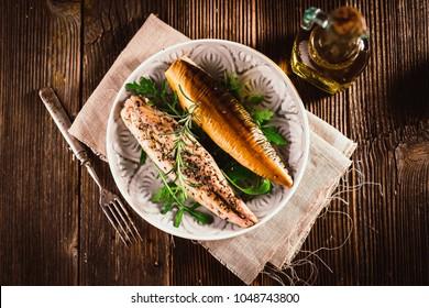 Smoked mackerel on wooden background
