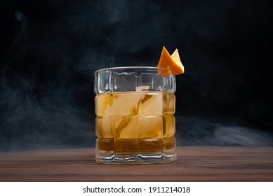 Smoked old fashioned on a wooden table