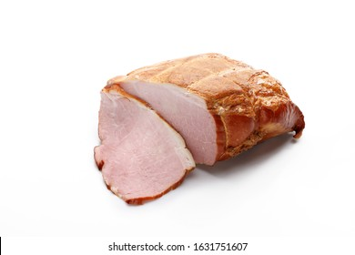 Smoked pork ham in one piece and cut into slices. Isolated on a white background.