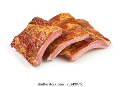 Smoked pork ribs, close-up, isolated on white background.