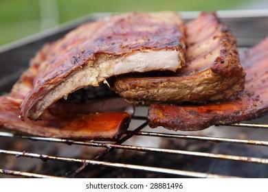 smoked pork ribs on a smoker grill, shallow DOF