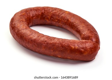 Smoked pork sausage ring, isolated on white background.