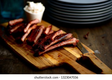 Smoked ribs ready to be eaten on wooden plate