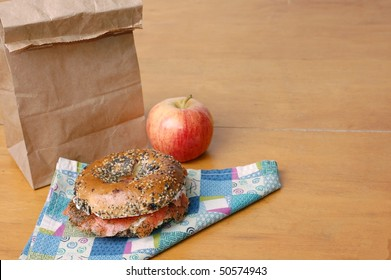 Smoked Salmon Bagel in a Brown Paper Lunch Bag