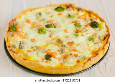 smoked salmon, Brussels sprouts and gorgonzola quiche tart, top view